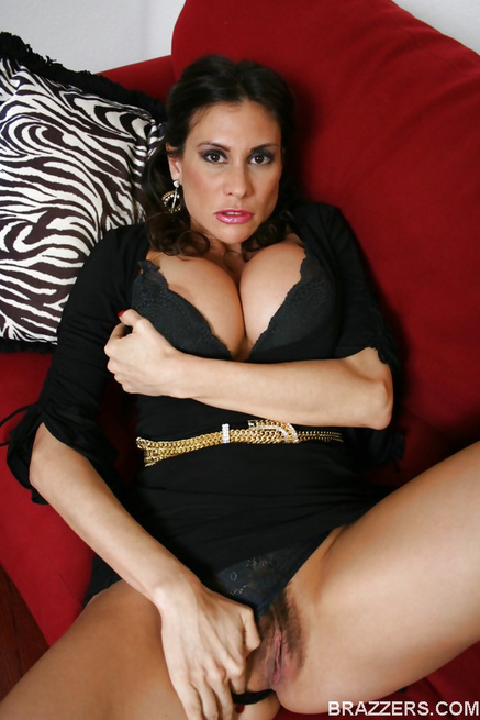 Black dress brunette gets fucked on a big red couch