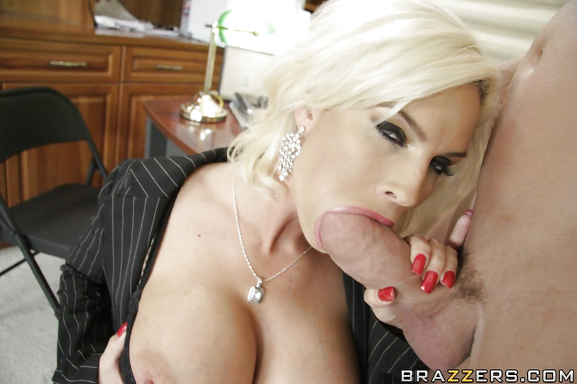 Blonde business woman is happy to be fucked in the office