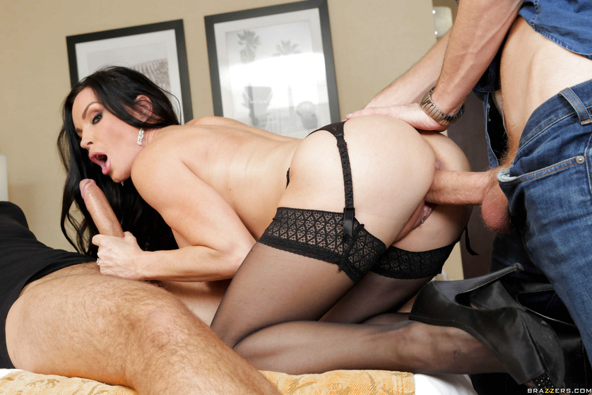 This juicy brunette loves playing with two big dicks at the same time