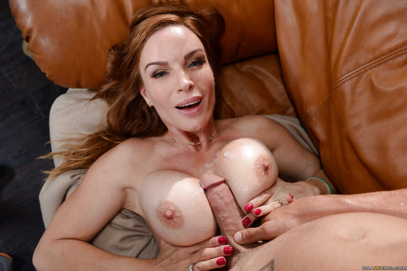 Redheaded MILF featured in a magazine gets fucked by a young dude