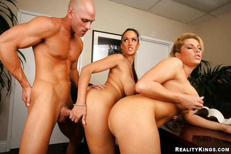 Threesome fuck in the office features two stunning secretaries
