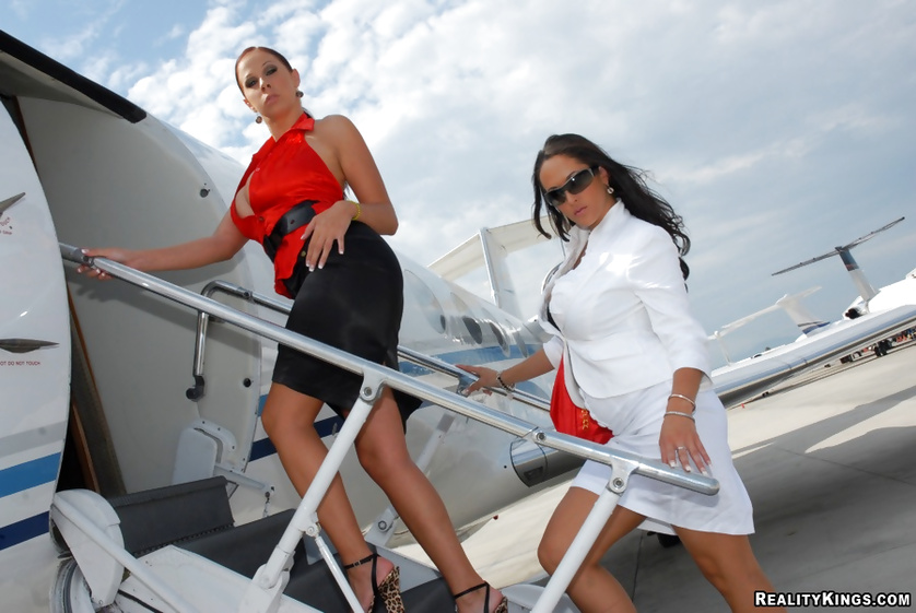 Doggy style sex of two tremendous MILF on a luxury airplane