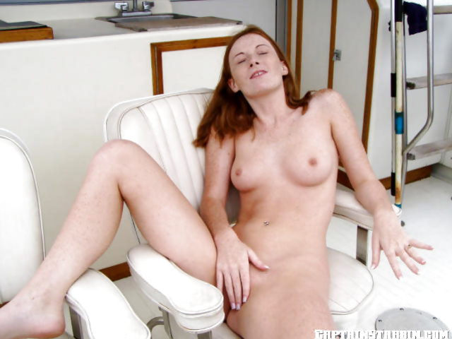 Young redhead gets fucked outdoor on a big yacht of her rich lover