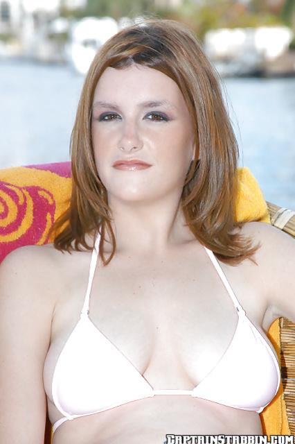 Seducing an amateur beauty in her fascinating bikini suit