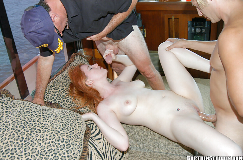 Double penetrating an amateur redhead with splendid tattoos