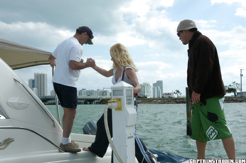Sweet blonde is getting drilled with two strong dicks on the big boat
