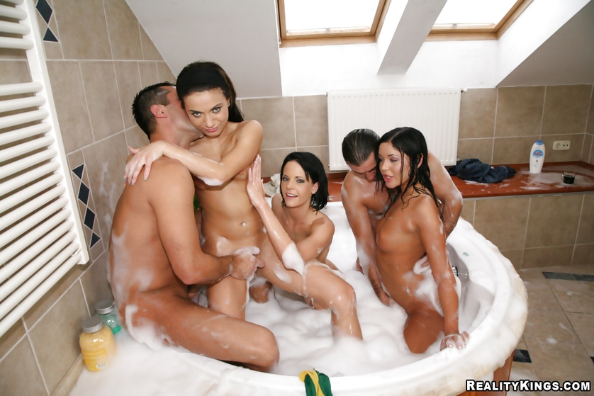 Three hot sluts are fucking with two guys in the bathtub