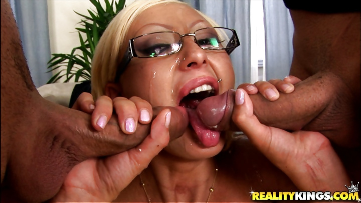 Woman wearing glasses can't stop eating cum
