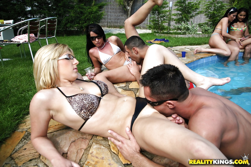 Sweet chicks are getting drilled next to the swimming pool