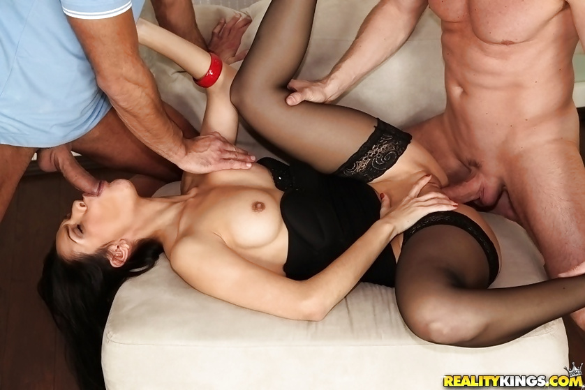Wonderful brunette in black stockings gets banged by two men