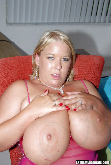 Woman in pink is showing her huge boobs and touching herself