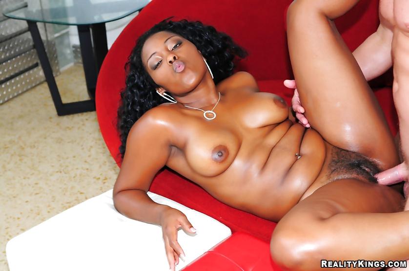 Ebony brunette loves taking care of extremely long penis