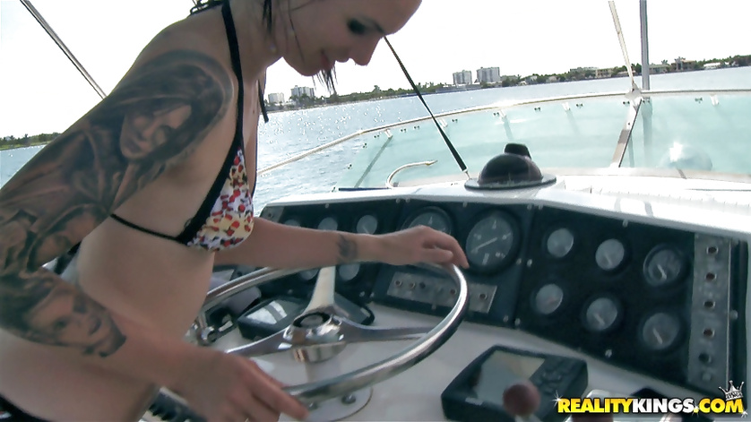 Horny brunette is pleasing herself on the big boat