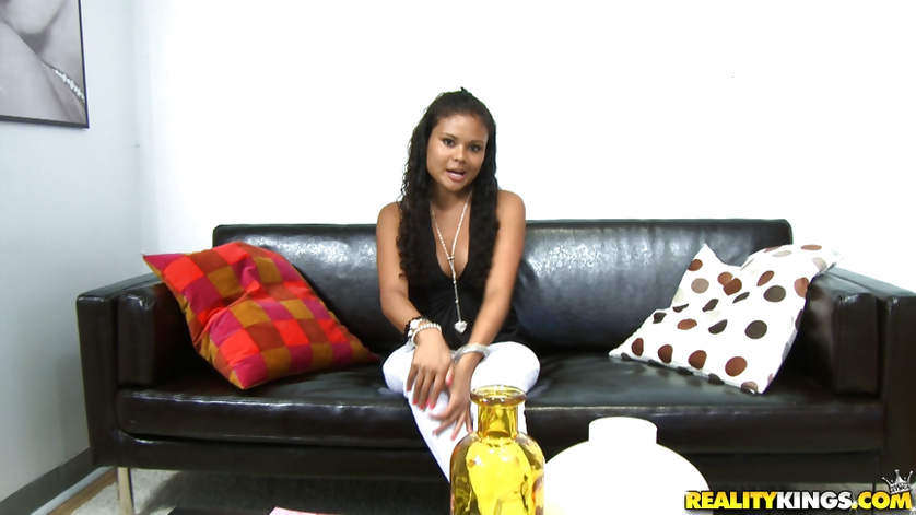 Slutty madam is enjoying solo on the big black sofa