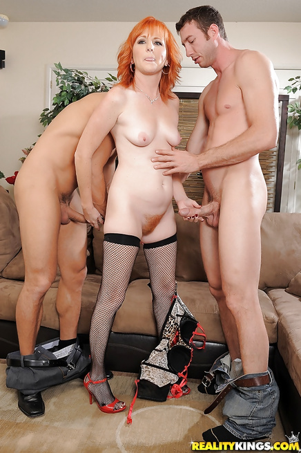 Redhead MILF is going mad having wild threesome