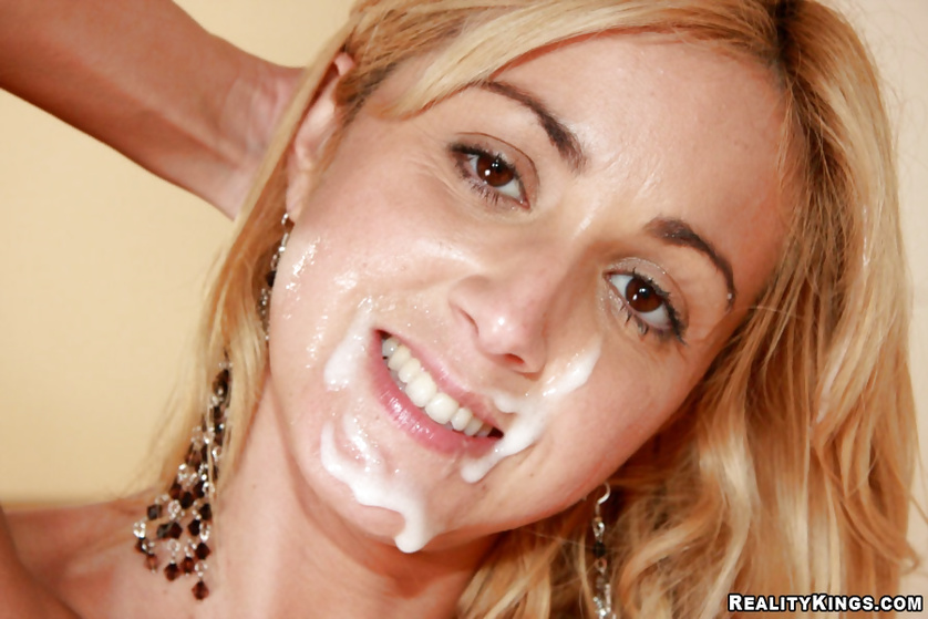 Blonde girl is getting her wonderful face covered with sperm