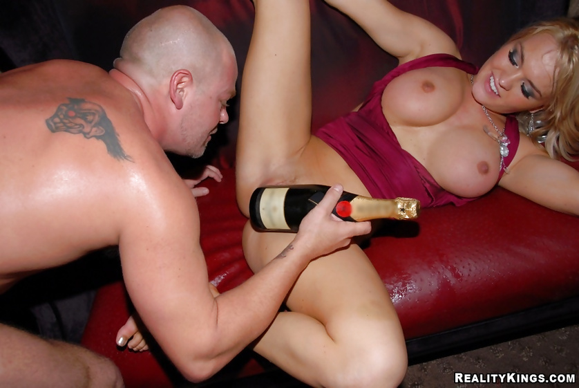 Woman in red dress is fucking and drinking
