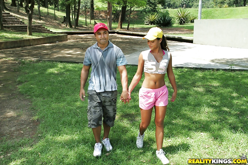 Brunette wearing yellow hat is pleasing her strong partner