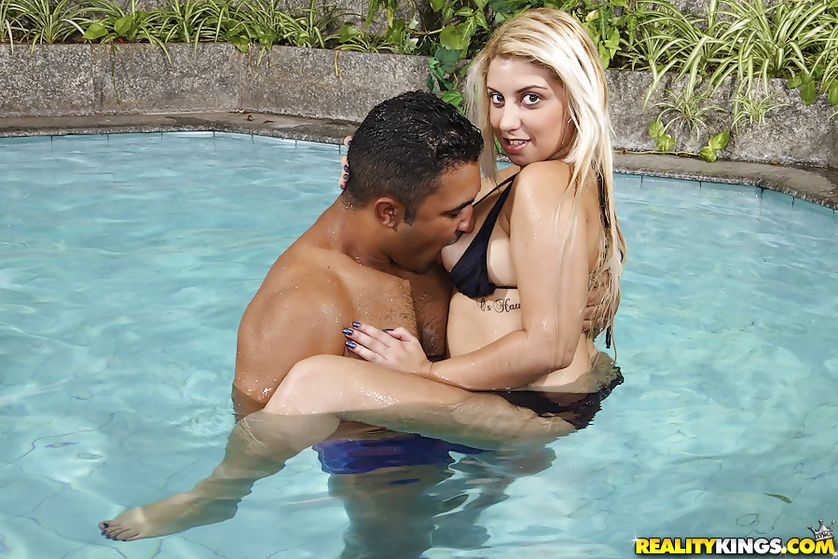 Wet blonde woman is getting banged outdoor