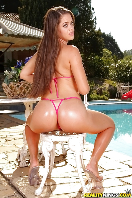 Satisfying sweet brunette in bikini next to the pool