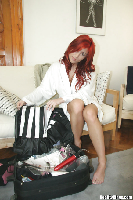 Redhead woman is going mad touching herself