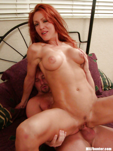 Redhead lady is fucking and masturbating at the same time