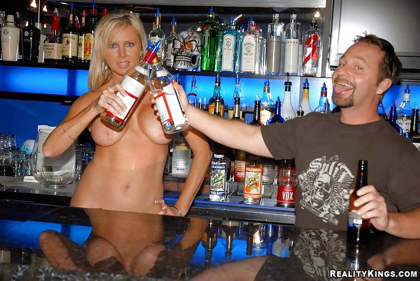 Blonde is drinking in the bar and getting punished