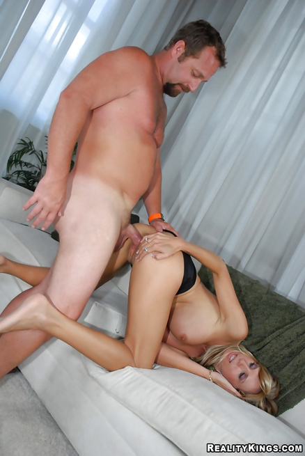 Older lady having fake tits is feeling good being penetrated