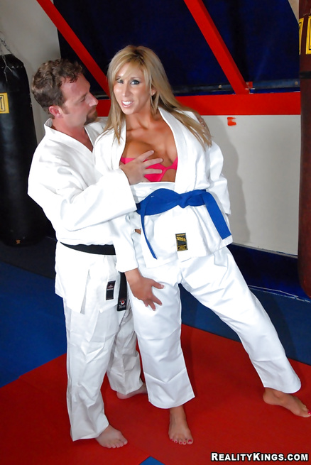Karate woman is getting her sweet holes fucked wildly