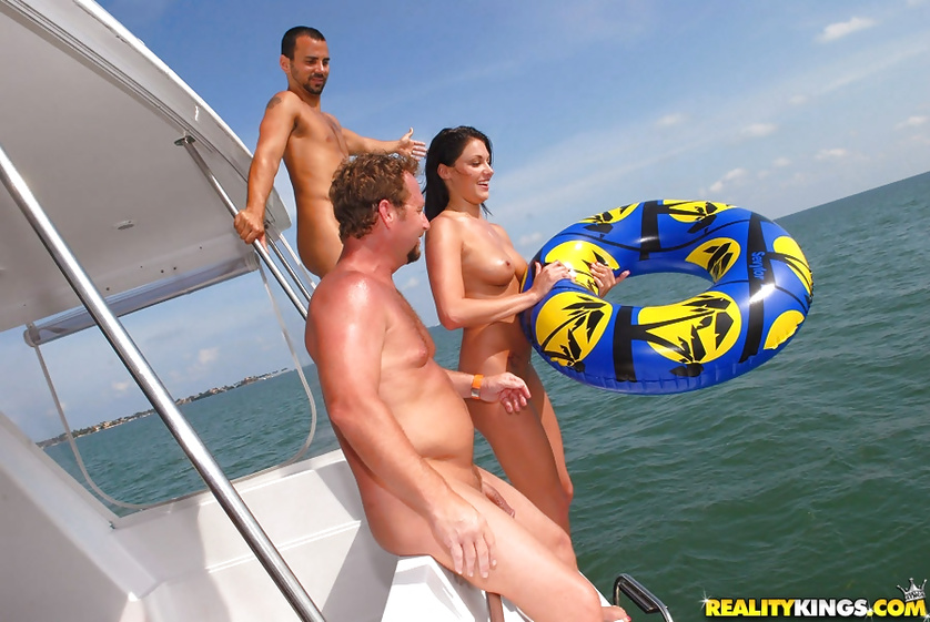 Two guys are drilling sweet brunette on the boat