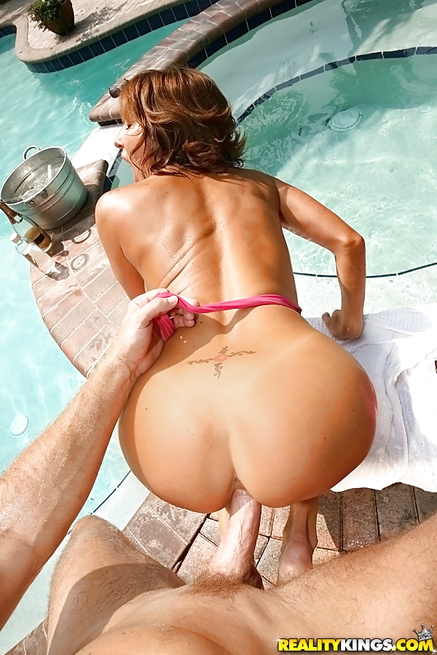 Busty lady is playing with big cock in swimming pool