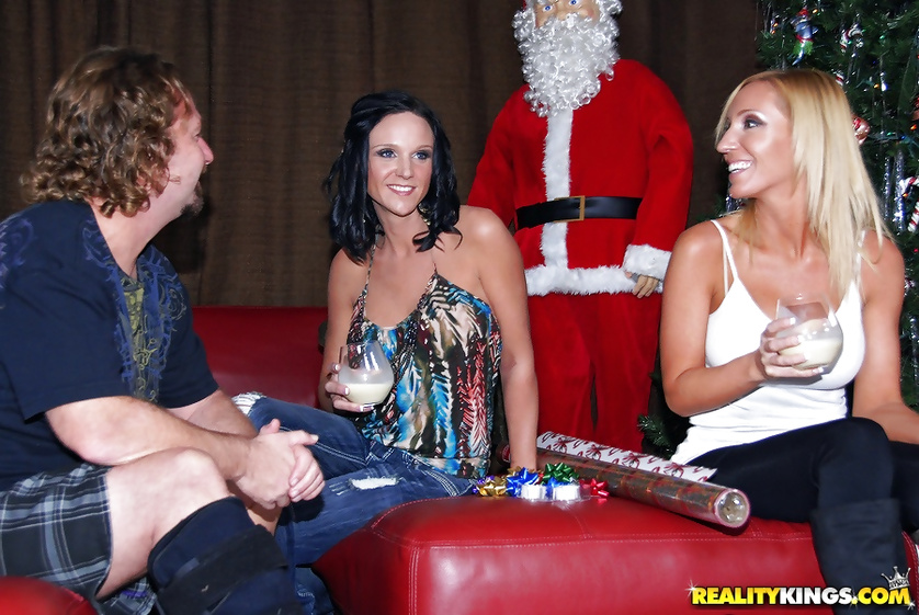 Filthy Santa is jizzing on beautiful faces of two wild ladies