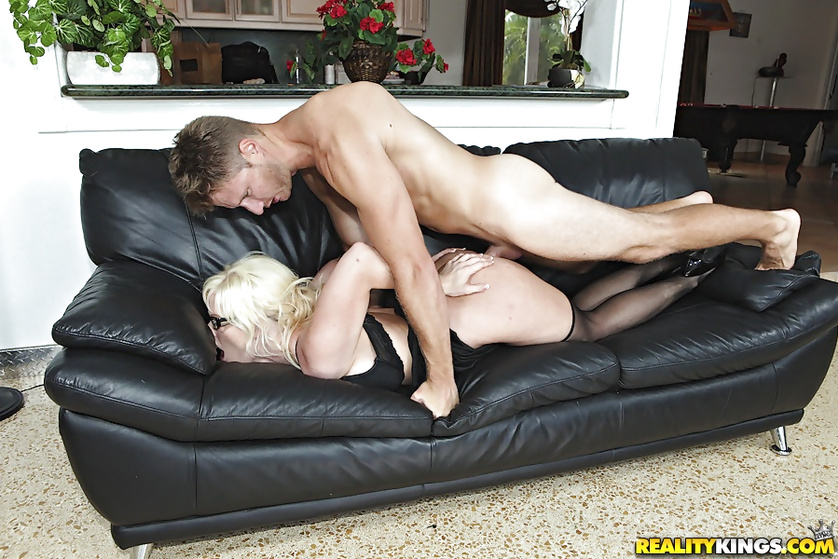 Blonde woman with white glasses is getting fucked hard