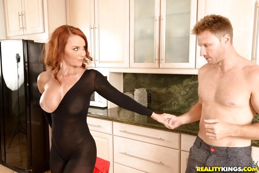 Redhead woman in black nylon wants it deeper