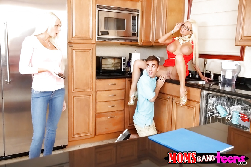Blonde in red is fucking with young partners in the kitchen