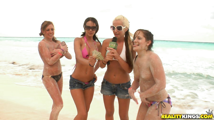 Tattooed man is fucking with sweet brunette on the beach