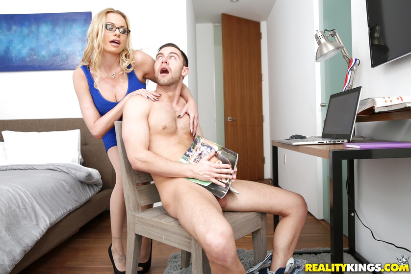 The man is jerking his cock when the blonde MILF comes in