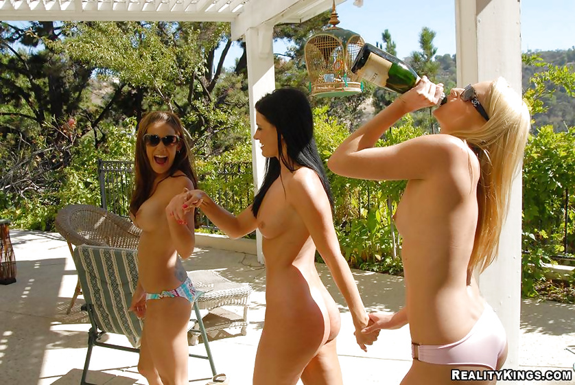Three women are drinking champagne and having wild sex