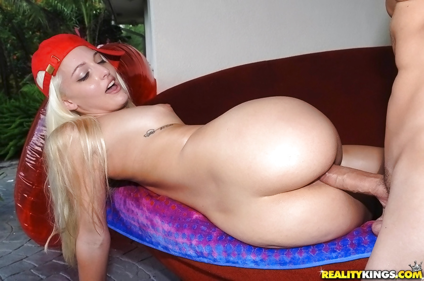 Blonde in red hat loves playing with strong penis