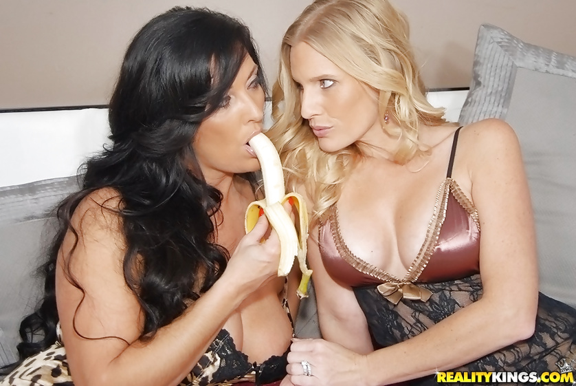 Amazing ladies are eating banana and fucking wildly
