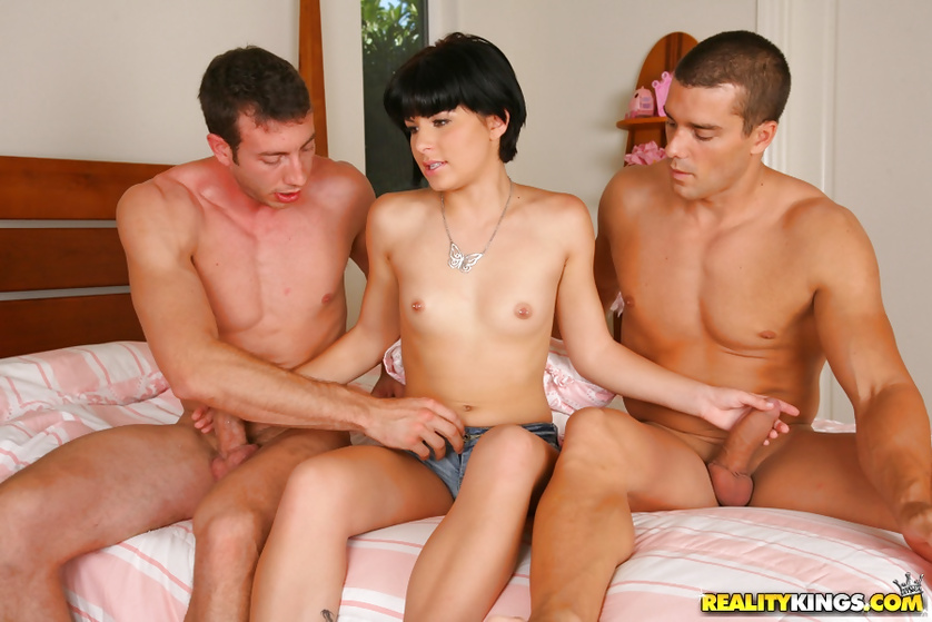 Two wild men are penetrating juicy brunette hard
