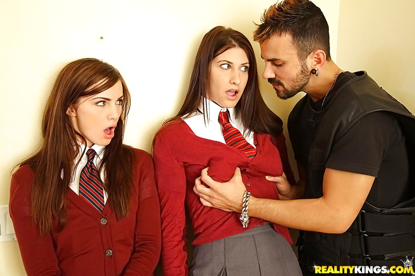 Two sexy schoolgirls are enjoying threesome with one guy
