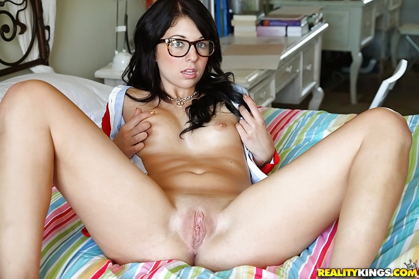 Brunette wearing glasses is enjoying hardcore sex session