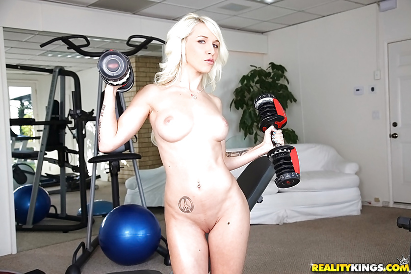 Lovely sport chick is enjoying passionate sex in the gym