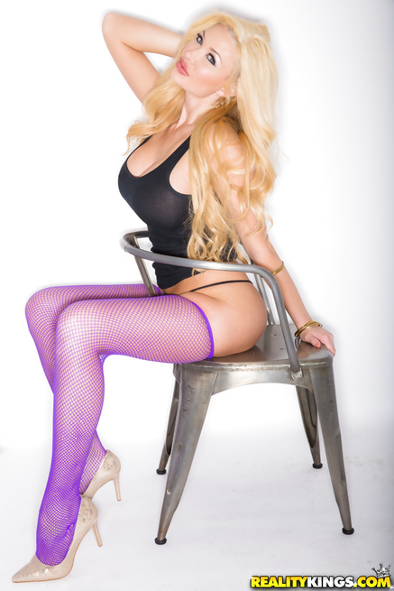 Drilling holes of wild blonde in purple stockings