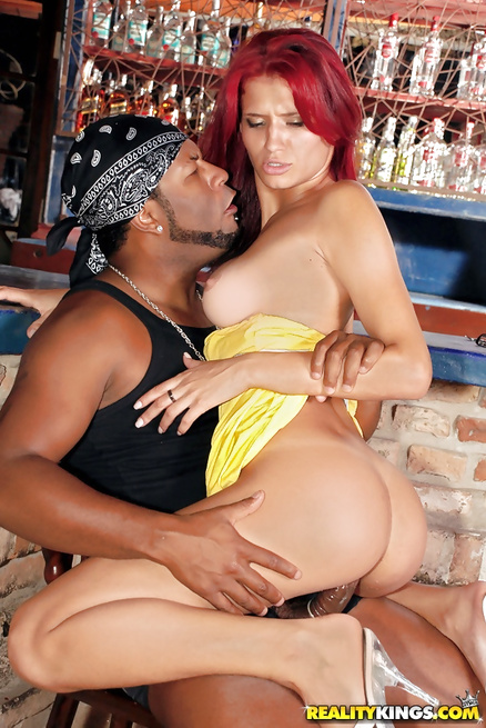 Redhead babe is getting drilled with big black cock in the bar