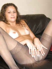 Welcome to the big room where sweet woman is touching herself on the big sofa. She is taking off her sexy stockings and fingering her twat.
