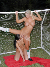Green soccer field is a great place for having unforgettable lesbian closeness. These lovely chicks wearing uniform are satisfying each other.