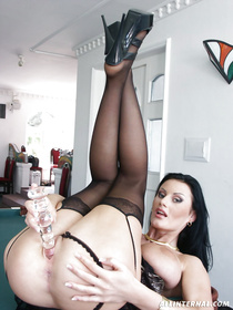 Posh madam having dark hair is looking hot wearing black stockings. She is laying on the big table and masturbating her hairy vagina.