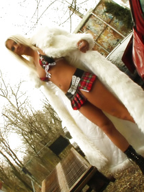 Talk about hardcore: this girl is wearing both a skirt and a fur coat. Her dreadful fashion sense however only highlights the fact that she looks awesome naked.